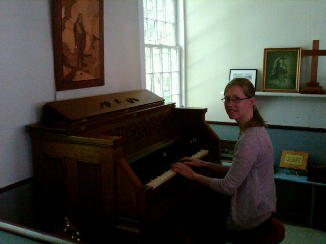 Ann at pump organ